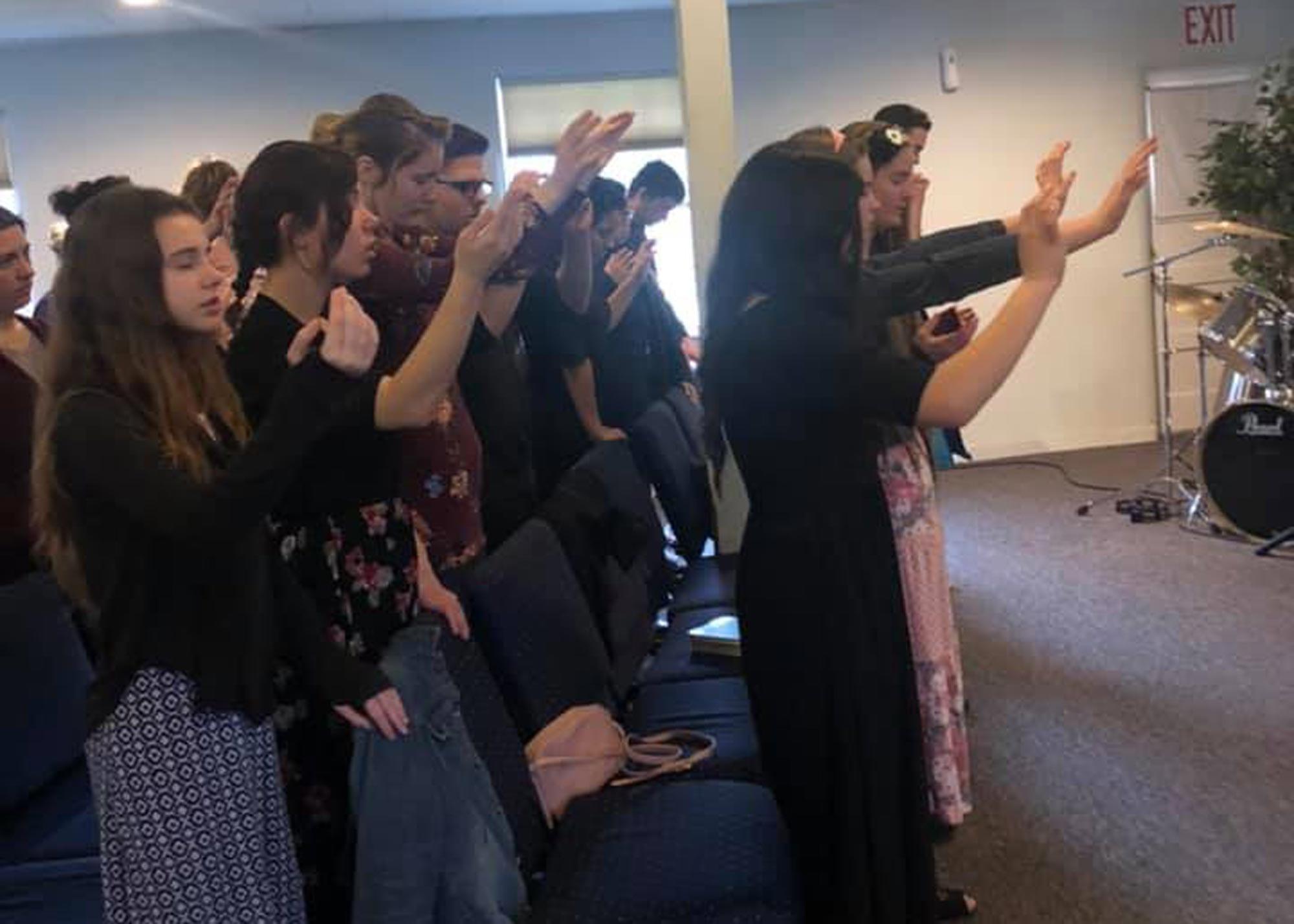 young people worshiping God at Medford Life Church